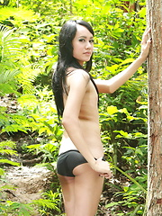 Young Ladyboy going for a walk in the forest and flashing her hard meat